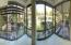 Panoramic view of courtyard/arboretum from Great Room. 180 degree views through wall of windows on 3 sides. Left=West; Center=North; Right=East