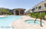 Enjoy relaxing by the community pool which is located directly behind this townhouse. Fitness center is also a short walk from the back patio.