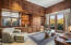 Spectacular Library/Office features solid Cherry wood paneling, cabinetry, crown molding and is currently being used as a den for TV viewing. French doors provide easy access to covered patio and spectacular views.