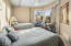 Bedroom 3 is located downstairs and offers a walk-in closet and en-suite bath.