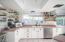 Kitchen w/ Custom Floating Shelves.