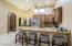 guest kitchen with nook and bedroom door