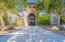Canopied by trees the gated front tower offers an entrance worthy of a royal couple