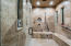 A steam shower to rest those aching bones or fill it with grandkids from the pool