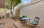 Secluded patio w/access out to pond and community pool