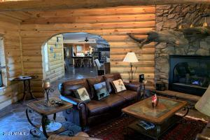 Mountain living at its finest! Log walls, fabulous mantle, flagstone floors