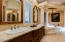 main level master bathroom with dual sinks and tub