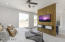 Accent wall provides added privacy from the sitting area and offers built in cabinetry and TV hook up for the bedroom.