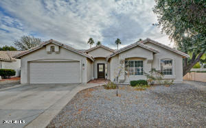 Pull up to this corner lot in highly sought-after Arrowhead Ranch!