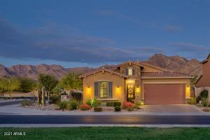 Situated on a corner lot, this home faces an open grassy park.