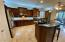 Extend kitchen - Added cabinets and large built in wine fridge