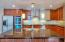 The kitchen features a large island with breakfast bar for casual dining.