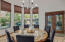 Kitchen with large breakfast nook or informal dining area overlooking the backyard