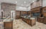 Kitchen features large prep island, breakfast bar, top of the line appliances and loads of storage