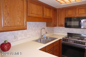 Oak kitchen cabinets are in great condition in the functional U shaped kitchen.