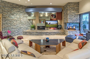 Great Room entertainment wall with AZ Ledgestone and two way fireplace.