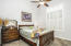 Secondary bedrooms feature ceiling fans, plantation shutters, and this bedroom has access to the hall bathroom.