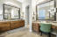 This spacious master bath offers a make up vanity as well.