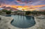 The resort style pool features a waterfall and spa with spillway into the pool.