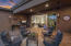 The covered patio is spacious and offers a sitting area and dining space.