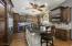 Custom kitchen with large island and wine fridge