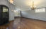 Stunning wood floors, plantation shutters and crown molding on main level