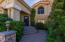 Gorgeous entrance with custom Cantera iron entry door