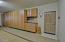 including work bench, epoxy floors, 3 separate garage doors