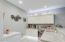 Basement kitchenette; ice maker, wine frig, cabinet lighting, granite counters