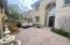 Enjoy happy hour in the courtyard with string lights and enclosed with a privacy gate.