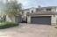 Beautiful front of home with iron privacy gate for courtyard entry.