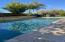 Gorgeous pool with tumbled travertine.