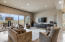 This living area by the kitchen is the perfect space to enjoy time with friends and family, including a built-in cabinet system under the TV and doors leading to the BBQ area outside for true indoor/outdoor living.