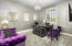 Office/den with elegant chandelier and custom sparkle paint