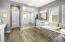 Oversized tiled with rain shower - dual showerhead Tiled garden tub