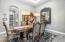 Formal dining w/elegant chandeliers