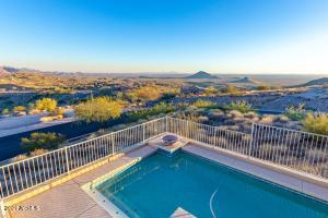Single level home, no interior steps. Pool is one stair case lower. Amazing hillside premium corner lot with panoramic views and city lights!