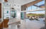 "Entry Foyer w/wet bar & bev fridge. 16"" x 16"" travertine tiles flow outside to patio!"