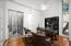 15' ceiling, 3/4 Bath, closet, & exit to the Zen atrium