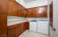 Tons of storage cabinetry, sink w/pull-out sprayer, PLUS gas hook-up for dryer