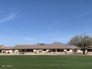Golf course condo with Red Mountain backdrop.