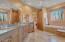 Granite bath counters, natural light, travertine floors.