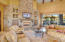 Stacked stone entertainment center, hearth and framed tv included.