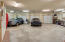 3 car garage, extended height ceiling.