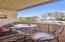 You will enjoy this covered patio which extends your living area. Look out onto the lush green lawns and fruit trees