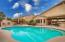 Backyard pool, built-in fireplace with seating, and built-in BBQ grill with bar/counter seating