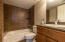 Time surround in bathtub/shower and granite stone counter tops.
