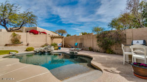 Resort-style backyard with beach entry pool, large backyard and plenty of room for entertaining family & friends.