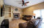 with Beautiful Custom Stone Fireplace and Built-ins