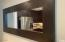 Mirror compliments the high end cabinetry